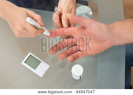 Doctor Check The Blood-sugar Level