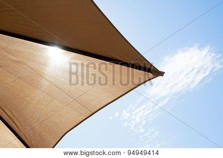 Bright sun shining through a parasol