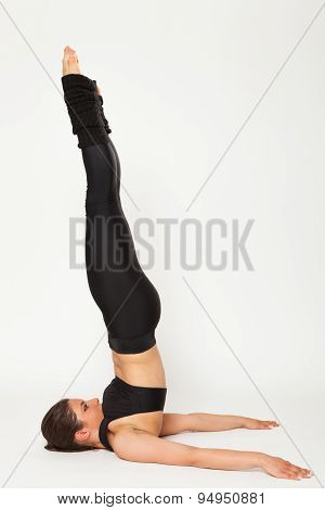 Sexy fit brunette woman in sportswear doing yoga exercises