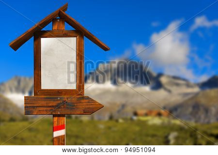 Wooden Directional Sign In Mountain