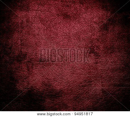 Grunge background of antique ruby leather texture