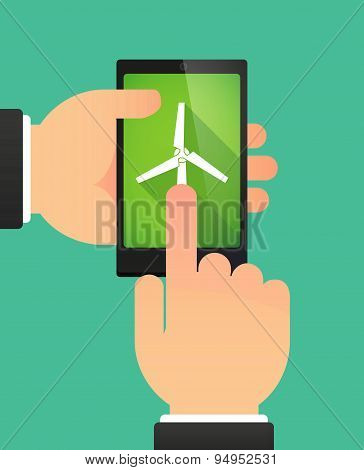 Man's Hands Using A Phone Showing  A Wind Generator