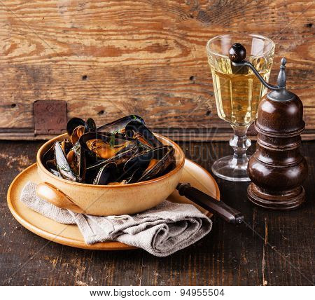 Mussels Clams In Bowl And White Wine On Wooden Background