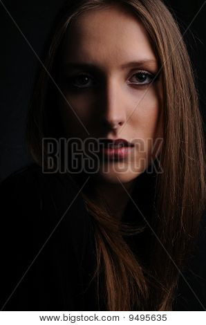 Portrait Of Young Woman On Black