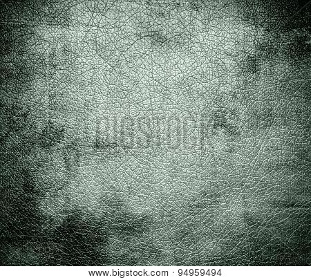 Grunge background of ash grey leather texture