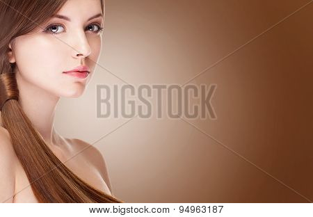 Girl With Perfect Skin Over Brown Background