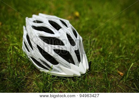 Bicycle helmet on grass