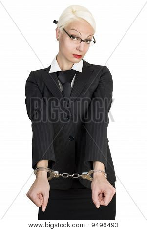 Young Business Woman With Handcuffs On Her Hands.