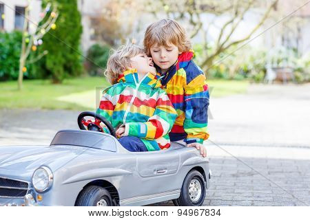Two Happy Sibling Boys Playing With Big Old Toy Car