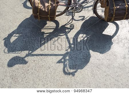 Shadow Of Vintage Bicycle With Touring Bag