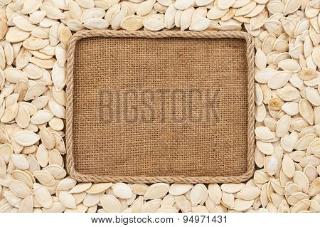 Frame Made Of Rope With Pumpkin Seeds On Sackcloth