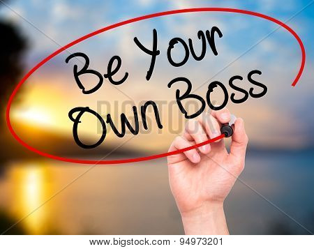 Man Hand writing Be Your Own Boss with black marker on visual screen.
