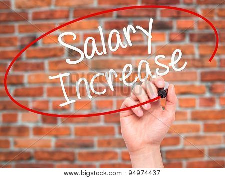 Man Hand writing Salary Increase with black marker on visual screen.