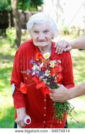 Old Woman With A Bouquet