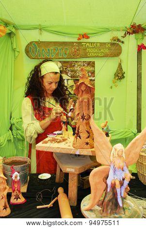 Artist painting fairies, Barbate.