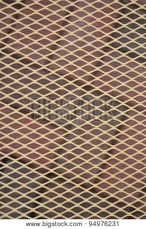 Diamond pattern layered over a brick patio background