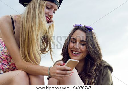 Beautiful Young Women Using Mobile Phone In The Street.