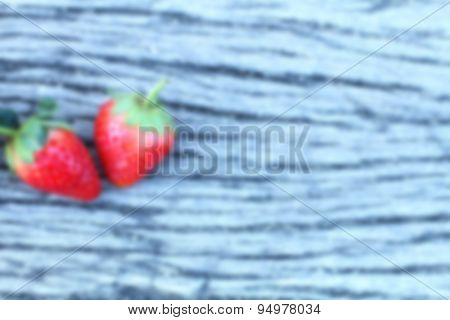 Blur Red Strawberries On Wood Table