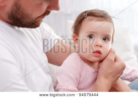 Cute kid sitting with  father.