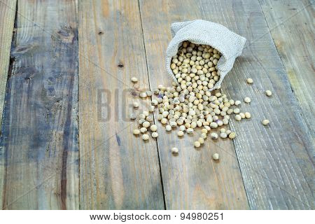 Soybean In Sack On Vintage Wooden Boards Still Life