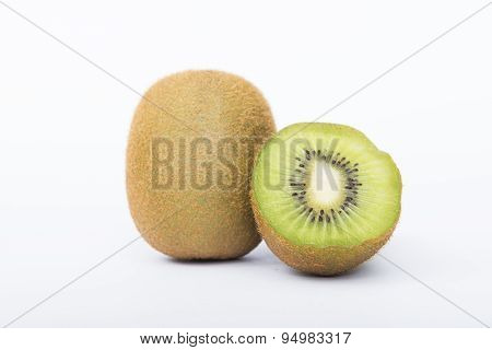 Whole kiwi fruit and his sliced segments isolated on white background cutout
