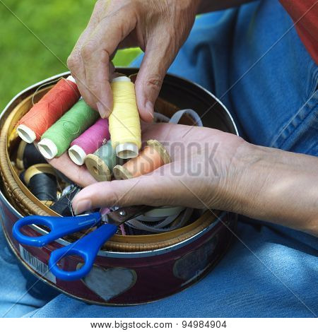 Hands With Spools Of Thread