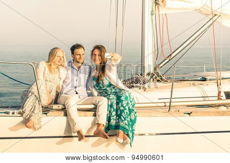 Young People Taking Selfie On Exclusive Luxury Sailing Boat - Concept Of Friendship And Travel