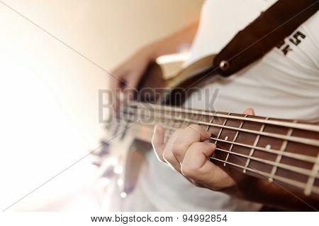 Man playing bass guitar