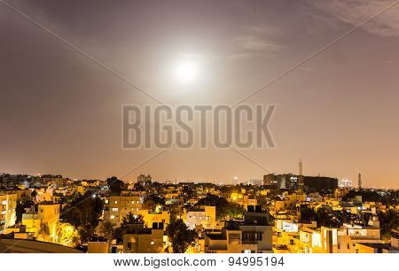Aerial view of a full moon light evening of an Asian city