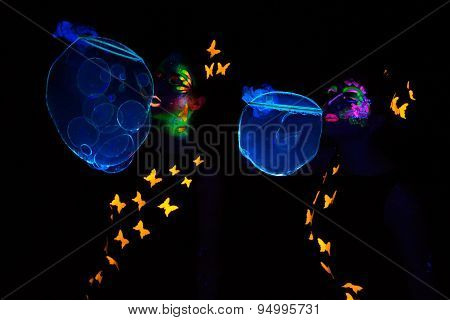 Image of women with bubbles, luminous make up