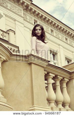 Elegant Girl On Retro Balcony
