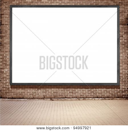 Black frame billboard with copy space hanging on brown brick wall near the street