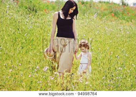Mother Walking With Toddler Girl