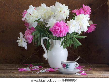 Tea And Peonies, Still-life With Tea And A Bouquet Of Peonies On A Wooden Table