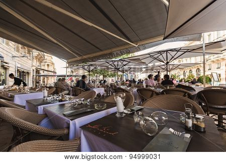 French Outdoor Cafe Tables Under A Canopy From The Sun, Bordeaux