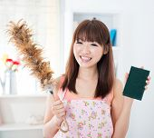 picture of apron  - Happy Asian housewife with apron housecleaning - JPG