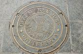 pic of manhole  - A city of San Jose California manhole cover on the sidewalk - JPG