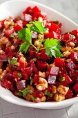 stock photo of cilantro  - Healthy salad from beet root walnut and cilantro