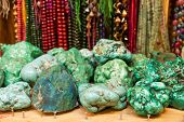 stock photo of malachite  - Malachite and jewelry in a souvenir shop in the Arab quarter of Jerusalem - JPG