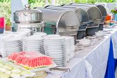 pic of buffet  - Many buffet trays ready for service made of stainless steel at buffet - JPG