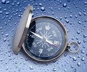 pic of raindrops  - Golden vintage compass opened on raindrop background - JPG
