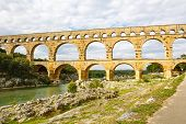 image of aqueduct  - Pont du Gard is an old Roman aqueduct near Nimes in Southern France - JPG