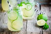 pic of mason  - homemade lemonade with lime mint in a mason jar on a wooden rustic table - JPG