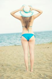 picture of sunbathers  - Young lady sunbathing on a beach - JPG