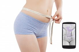 picture of measurement  - Beautiful caucasian girl measuring her waist with tape measure isolated on white background and weightloss and fitness app on spartphone screen - JPG