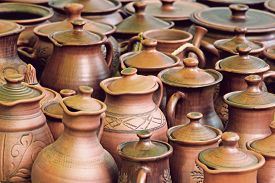picture of loamy  - Lot of ceramics pots for sale taken closeup - JPG