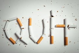 pic of tobacco smoke  - Broken cigarettes arranged as a word quit  - JPG