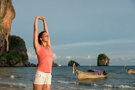 image of breathing exercise  - Sporty beautiful woman relaxing and stretching arms and back - JPG