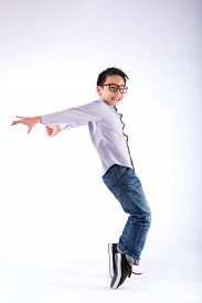 picture of freezing  - Cheerful young dancer performing freeze move on his toes - JPG