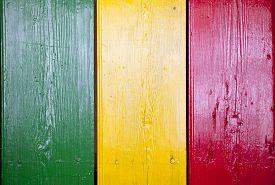 stock photo of reggae  - Reggae bright colors over wooden door - JPG